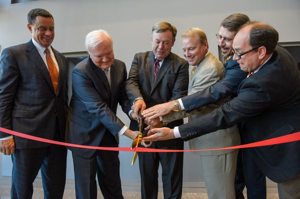 President Crow and other dignitaries break the ribbon at the grand opening of the College Avenue Commons
