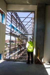 Jeff Ehret looking at the building while it was under construction