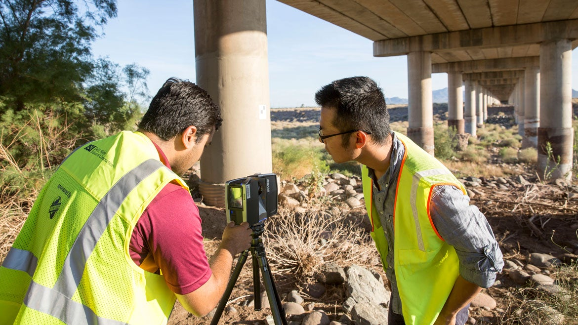 Pingbo Tang and his graduate student collect data near Tempe Town Lake