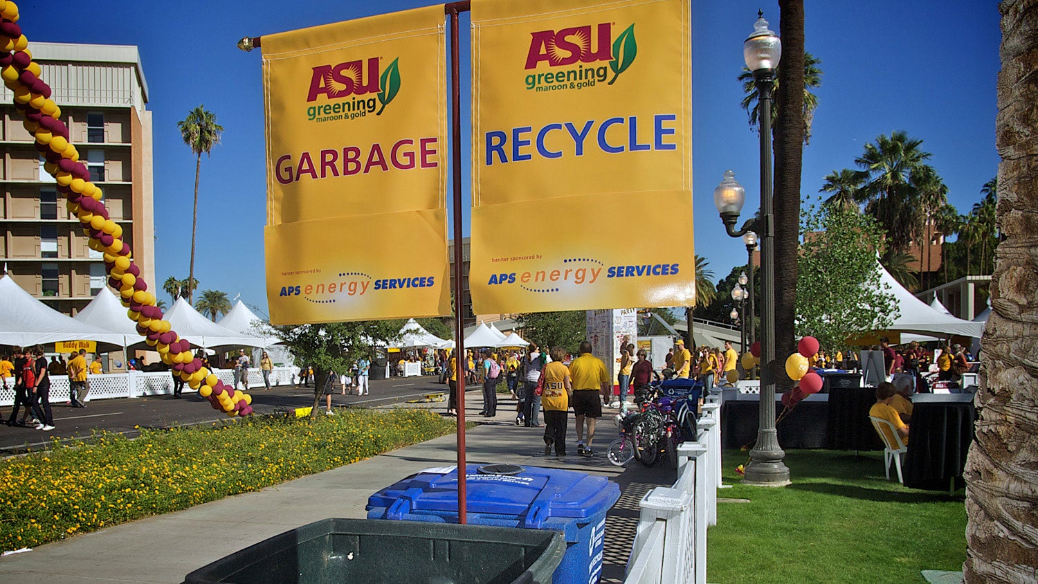 An outdoor ASU event is pictured, with ASU's special garbage and recycling containers in view.