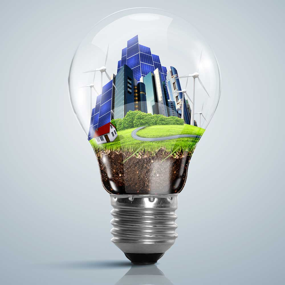 Stylized artistic image of a lightbulb full of an entire sustainable community from the ground up.