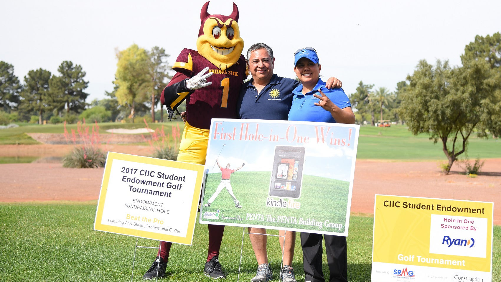 ASU's Sun Devil mascot, Sparky, stands with two sponsors at the CIIC Golf tournament