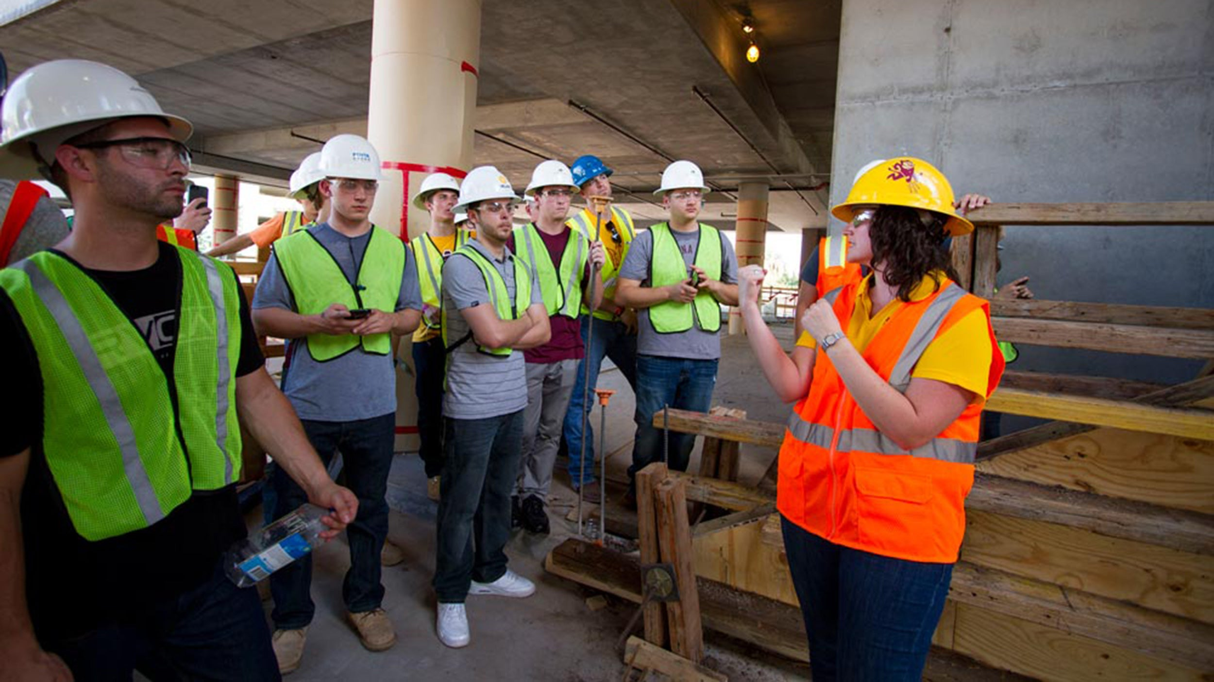 Kristen Parrish, graduate program chair for construction management, leads a group of students at the CAVC construction site