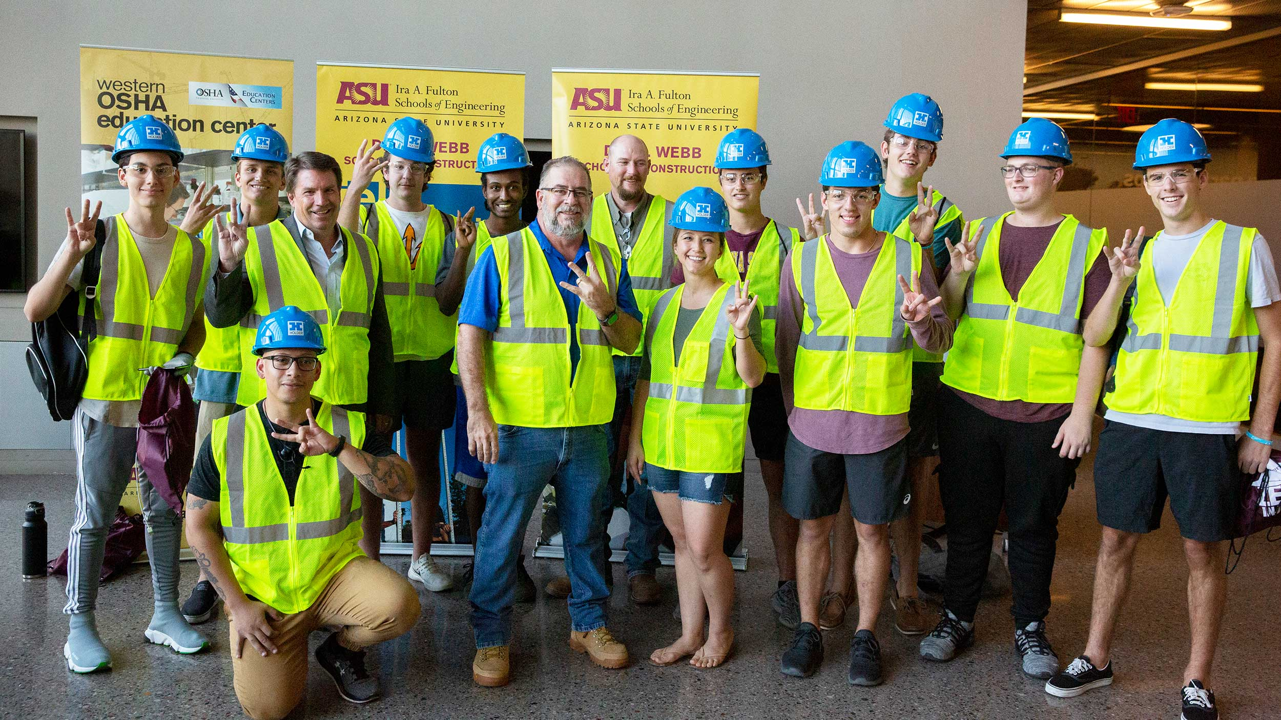 "A group of newly ""vested"" construction freshmen stand for a group photo with faculty and industry professionals"
