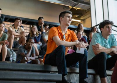 Students sit listening to a speaker at the DEWSC vesting ceremony